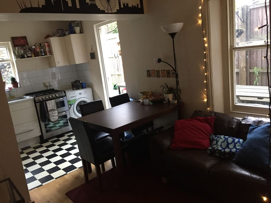 Lounge and dining area with a cosy couch