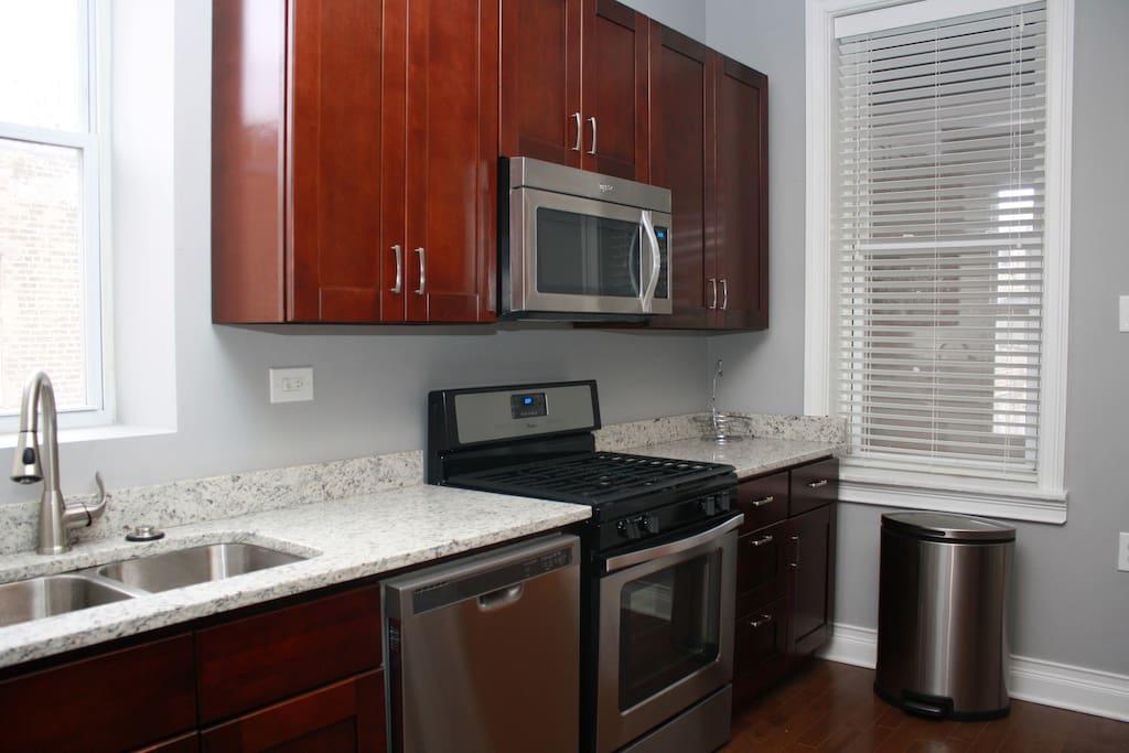 Kitchen with SS appliances, dishwasher, garbage disposal.