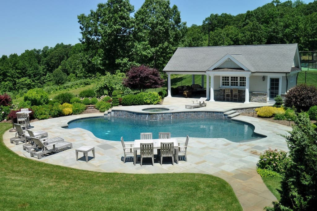 HEATED POOL, JACUZZI AND A POOL HOUSE AVAILABLE FOR USE MAY TO OCTOBER