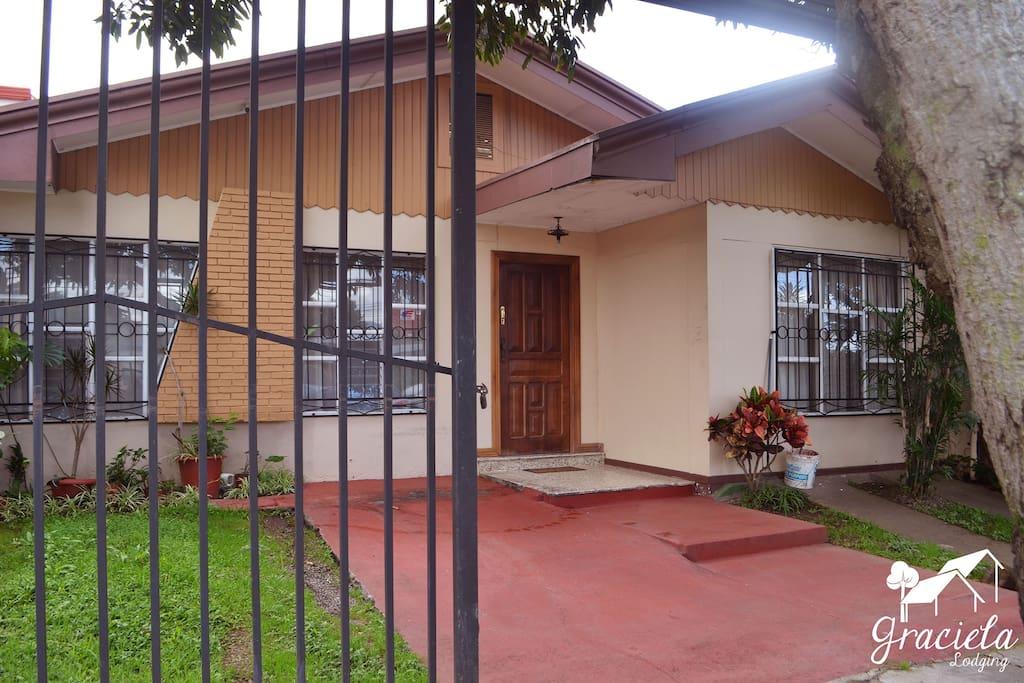 Front view of the home.  Gated parking for one vehicle, in this area.