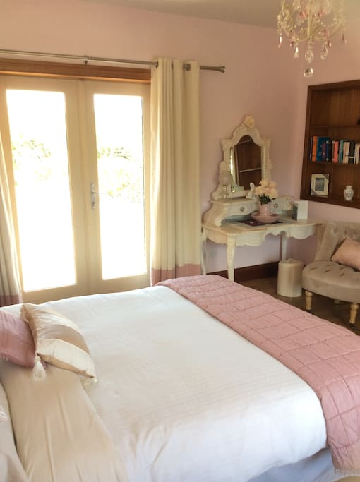 Beautiful bright bedroom with own private entrance.