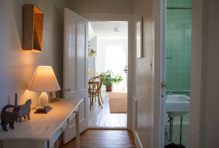 Hallway with view to kitchen and bathroom.