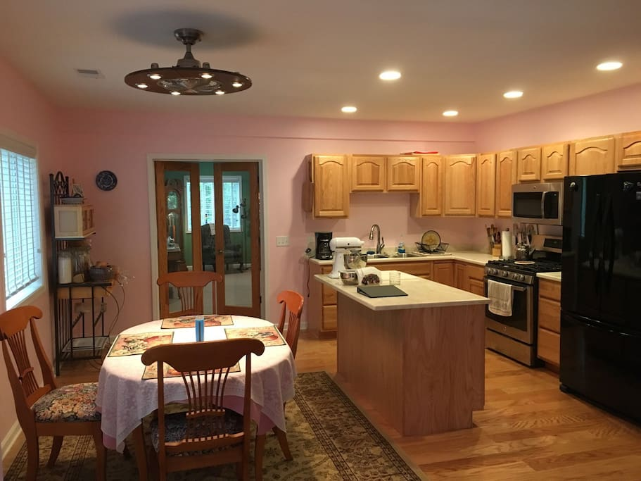 Kitchen with gas range, grill, oven & large frig