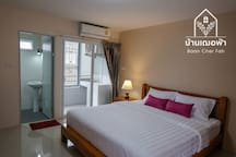 6 ft King size comfortable bed in the room with air conditioner and balcony.
