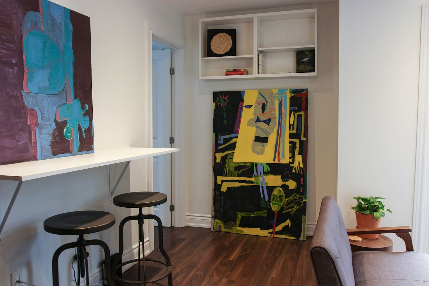 Living and dining area with artwork by local artist