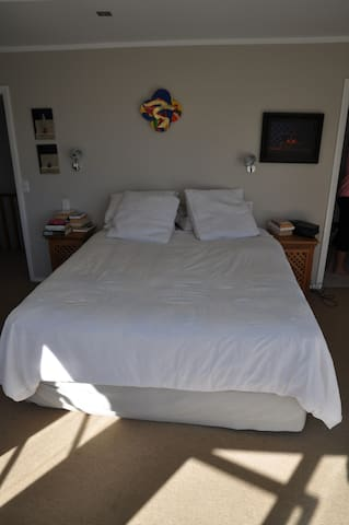 Master Bedroom, king sized bed, view out to Wellington Harbour and beyond