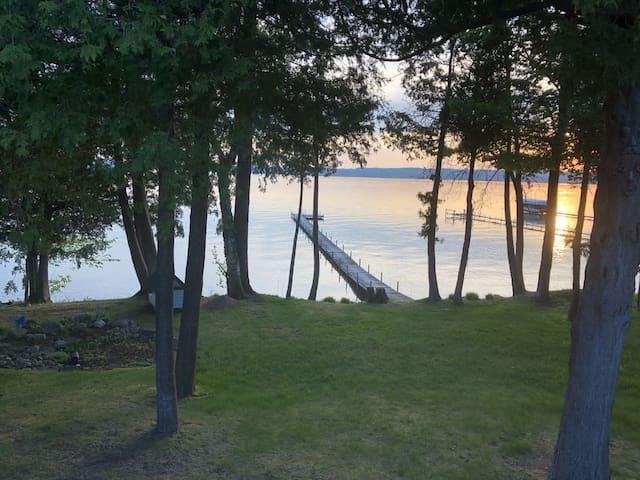 Large Lakefront Burt Lake Home with Sunset Views