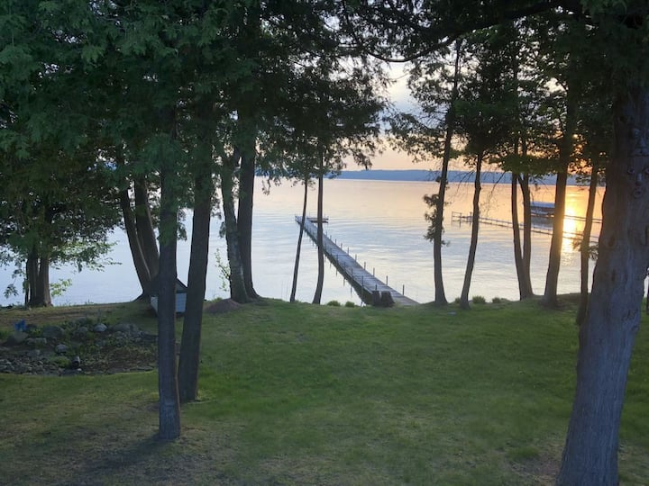 Large Lakefront Burt Lake Home with Sunset Views