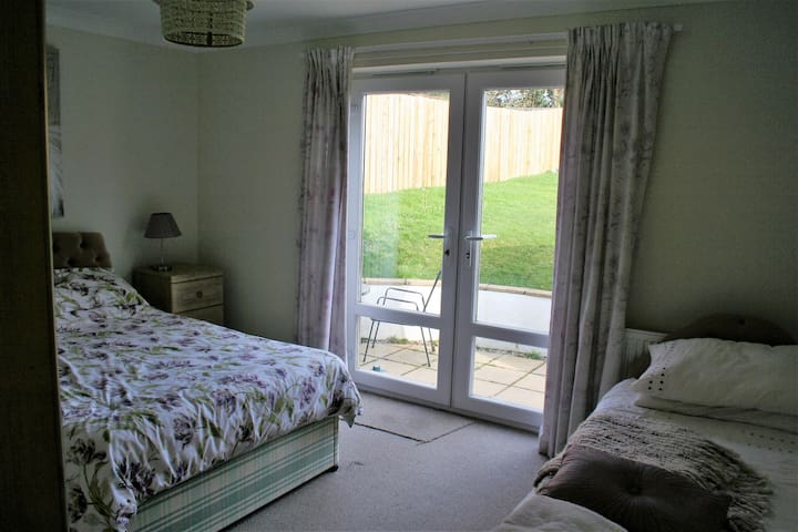 Rear Bedroom which has a single and double bed plus access to rear patio area.