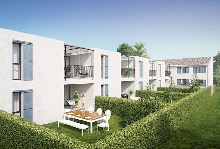Outside view of the apartment. The apartment is located on the ground floor, next to the swimming pool.