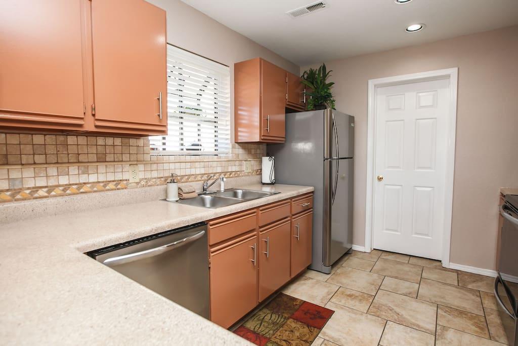 Kitchen. Has microwave, range / oven, dishwasher with detergent, & fridge & ice maker.