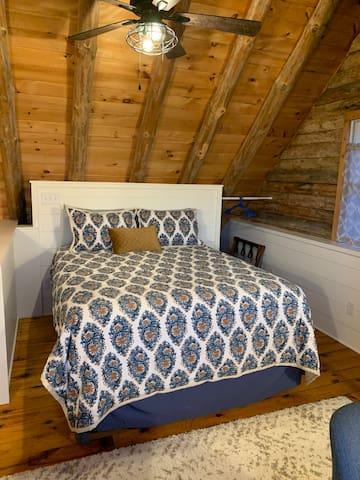 Queen size bed in upstairs loft/bedroom