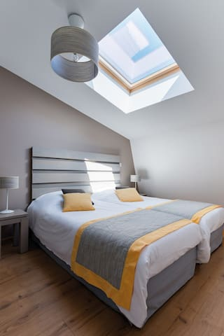 The master bedroom features 2 single beds and may have a skylight!
