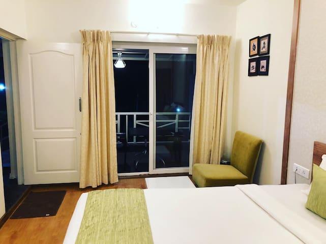 Delightz Inn -Studio Balcony with garden view