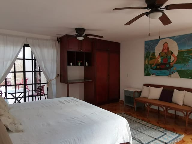 Bedroom 1. King Size bed, seating area, private bathroom and private terrace