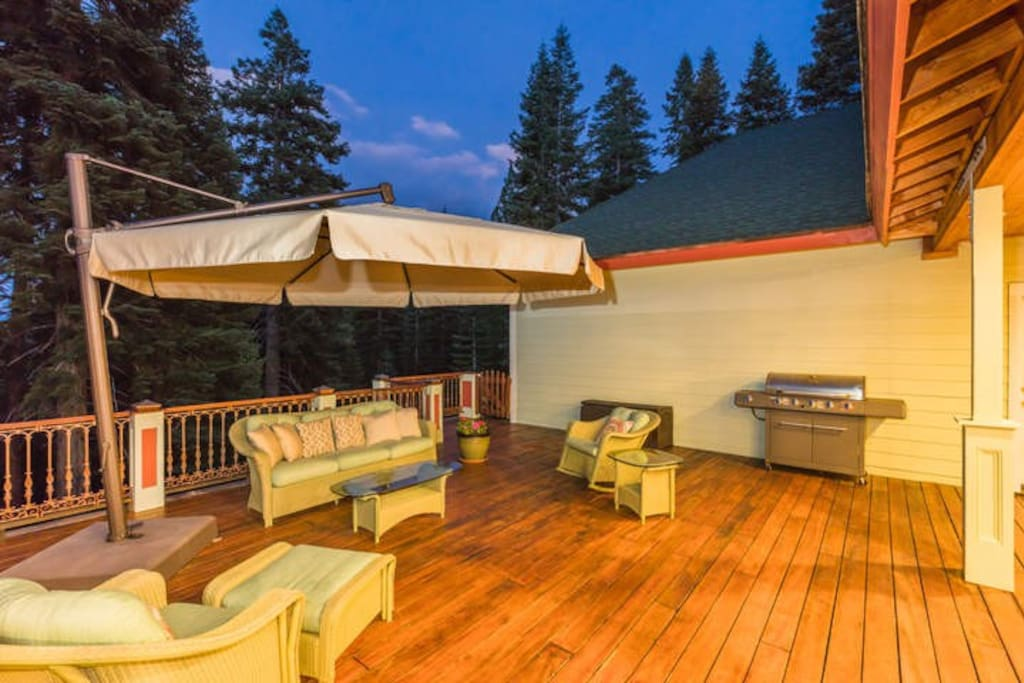 The back deck has a gas grill and seating for five.