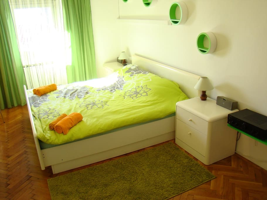 Another bedroom features king size bead nice relaxing green ambient and sound sistem