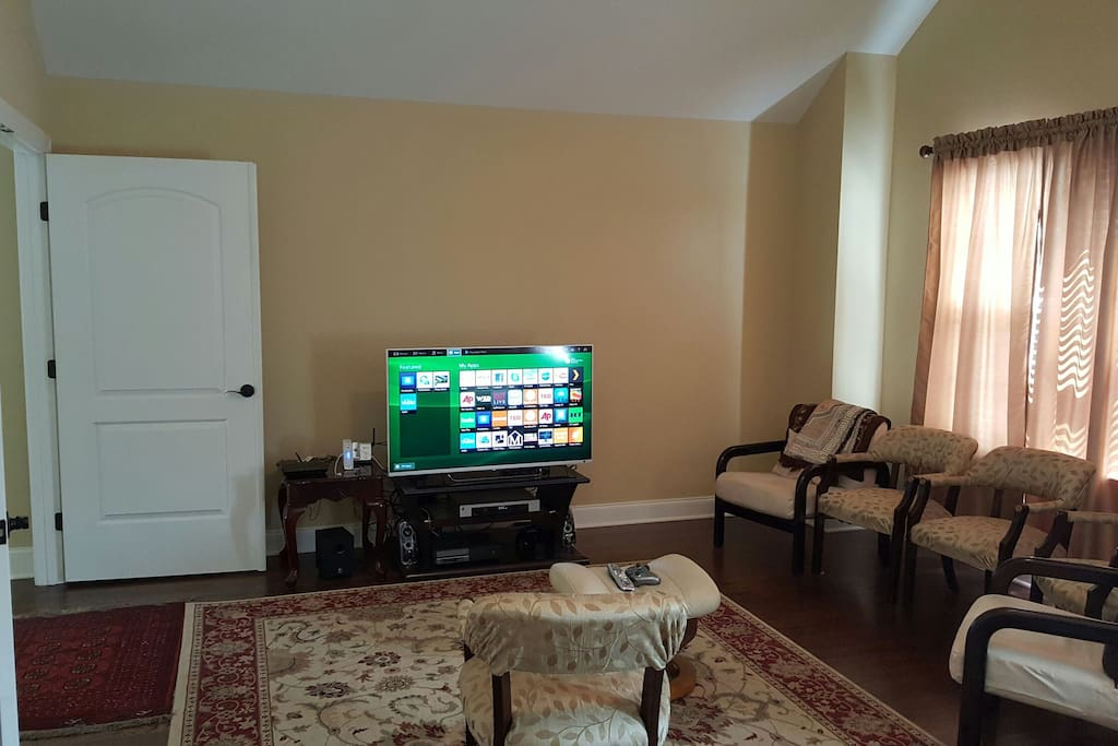 Entertainment room with wrap around sofa, seats, and full bath (behind me) Happy entertaining!