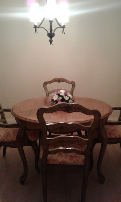 Dining room table and chairs. It does have a leaf to make it larger.