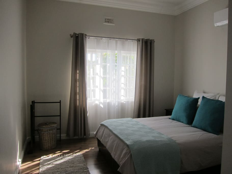 Main bedroom with queen bed and airconditioning