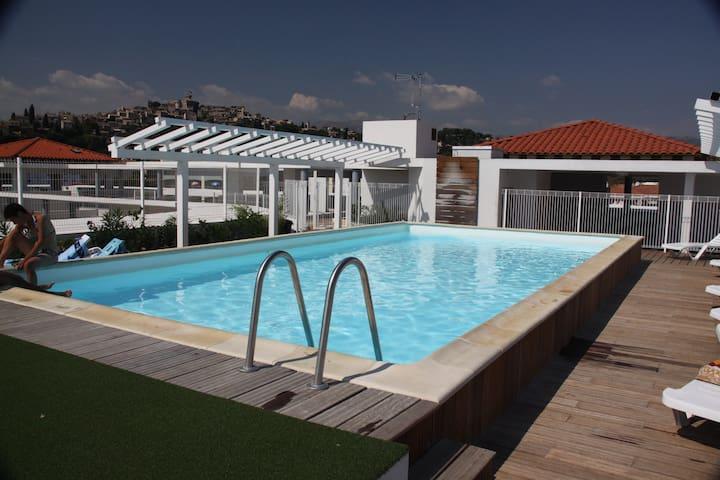Appartement climatisé + Piscine sur le toit d'un solarium