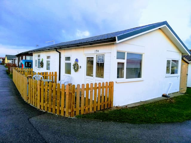 Pet friendly chalet by the sea, lovely sandy beach