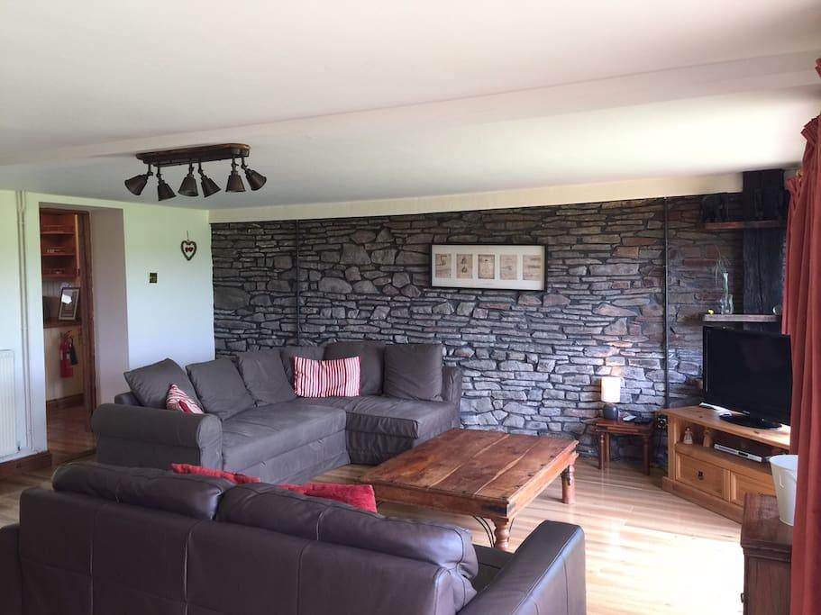 Comfortable lounge with door onto back garden.