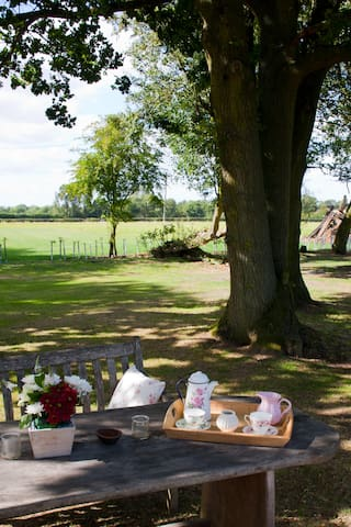 Enjoy early morning tea looking over the fields