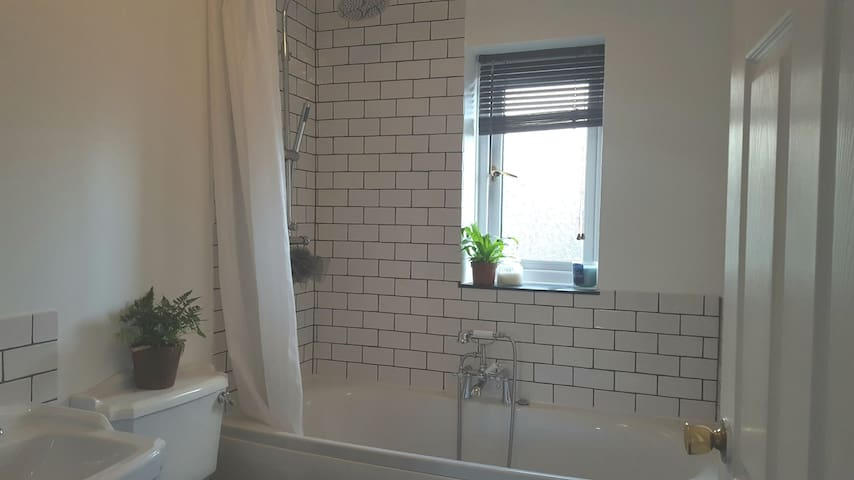 Bathroom with monsoon shower, double ended bath and underfloor heating