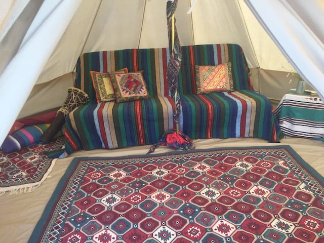 Cosy canvas bell-tent on traditional organic farm