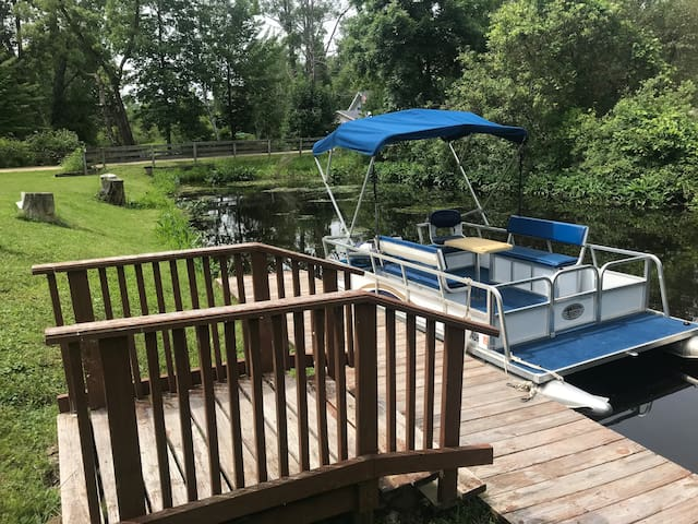 Pontoon boat is available for rent. Explore the nine lakes in the Martiny Chain of Lakes.