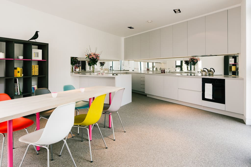 Generous modern kitchen with Corian worktop, breakfast bar and all mod cons
