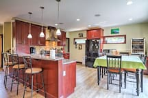 When hunger strikes, head over to the kitchen and dining area, which boasts both a breakfast bar and dining table.