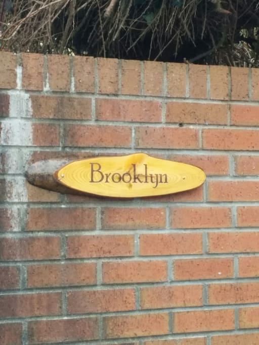 Big red brick wall to welcome our guests