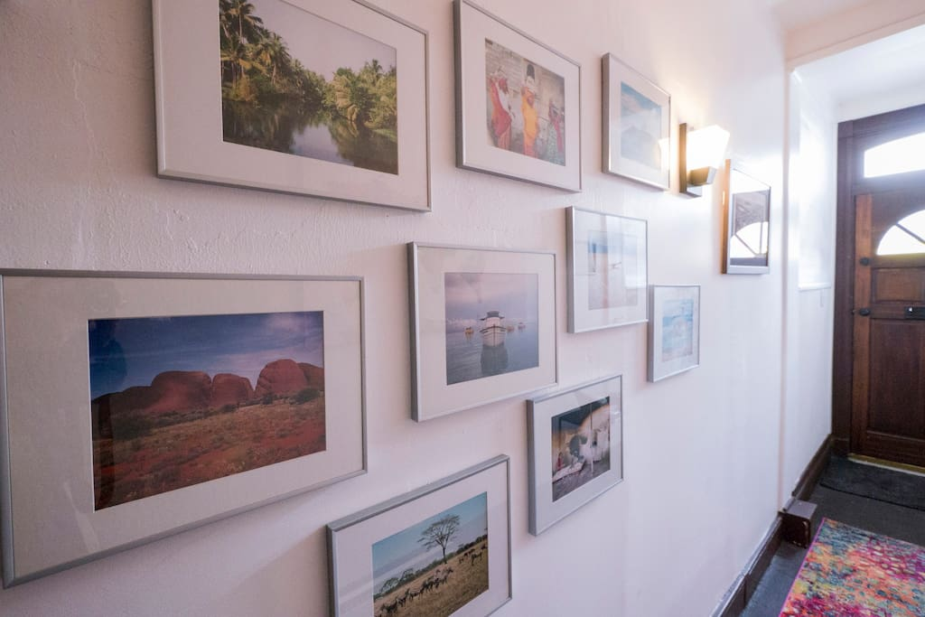 Entrance hall filled with inspirational travel photos.