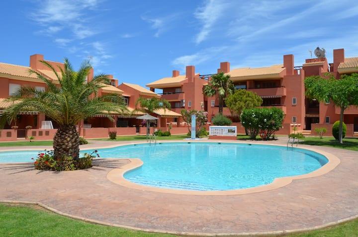 Ground floor apartment, huge patio, communal pool