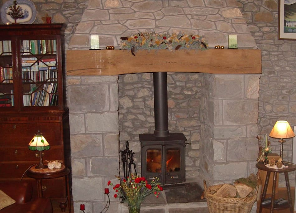 A welcoming log fireplace