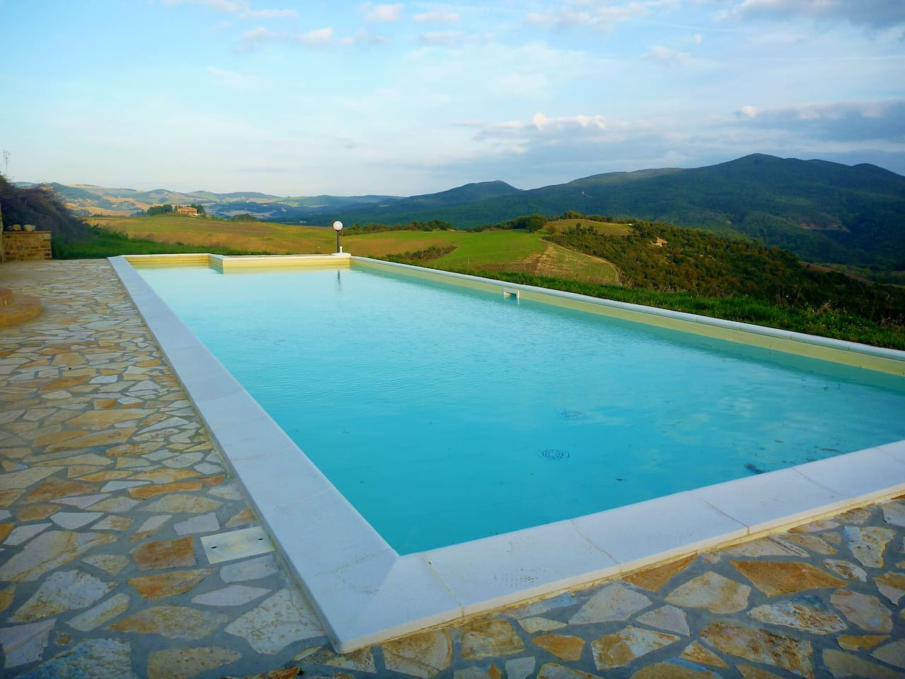A brilliant pool surrounded by nature with glorious views.