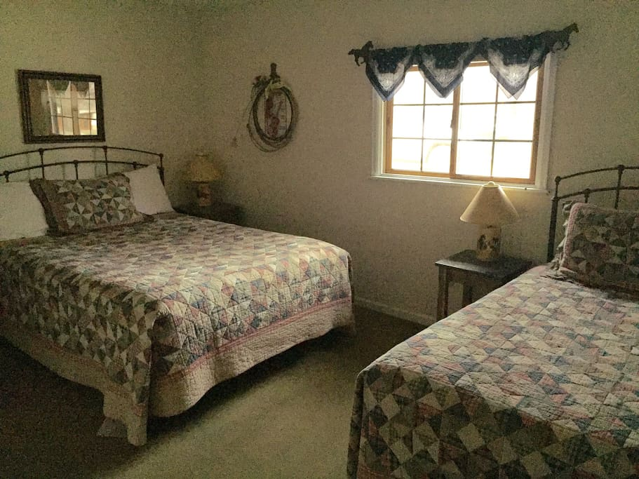 The bedroom has a double bed and a single.