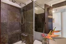 Stone Tiled Standing Bathtub Walls.
