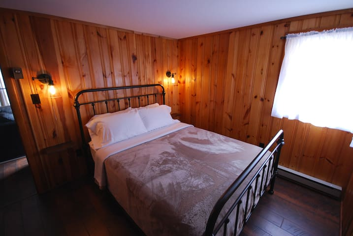 The third bedroom offers a comfortable queen size bed.