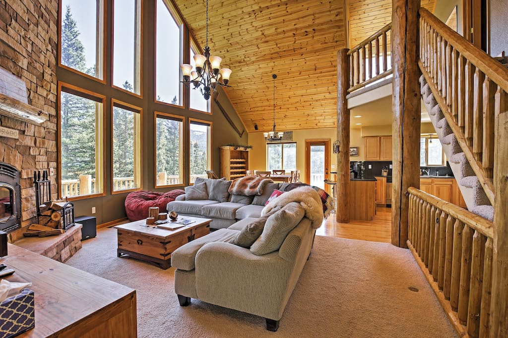 Large windows provide mountain views while you unwind in the living room.
