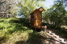 Traditional outhouse with EcoFlo composting nature loo. Big,  mirrored windows let you watch the fairy wrens and other birds - but they can't see you!  :-)