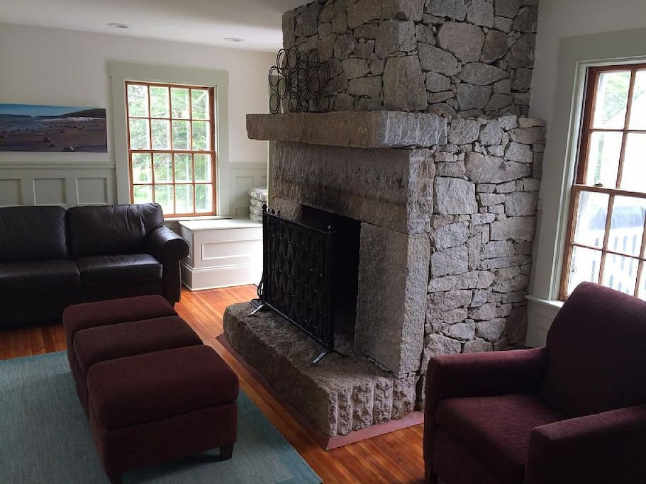 Giant granite fireplace in the kitchen