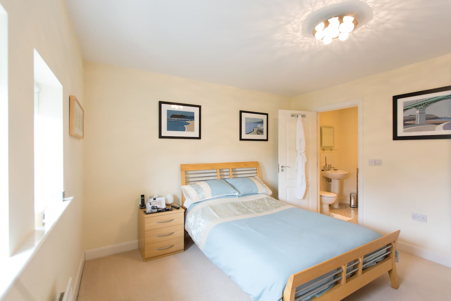 Larger than most Double en-suite light and airy double bedroom with oodles of thoughtful touches, inc modern wardrobe with mirror, chest of drawers, TV with integrated DVD player, writing desk and thoughtful guest touches to give you a memorable stay