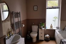 Bathroom with double shower and bath