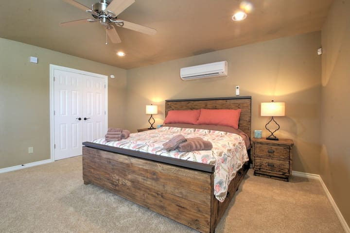 King Sized Bed with Drawers underneath the Bed. Showing Closet and efficient HVAC on Wall
