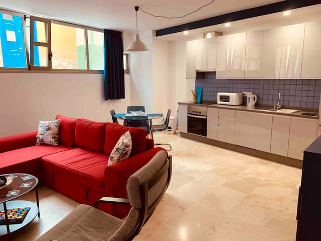 Spacious open plan living, kitchen and dining area. View to quiet lane. Special windows stop people seeing into the apartment.
