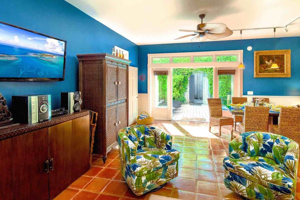 The living room features a large flat screen Smart TV...