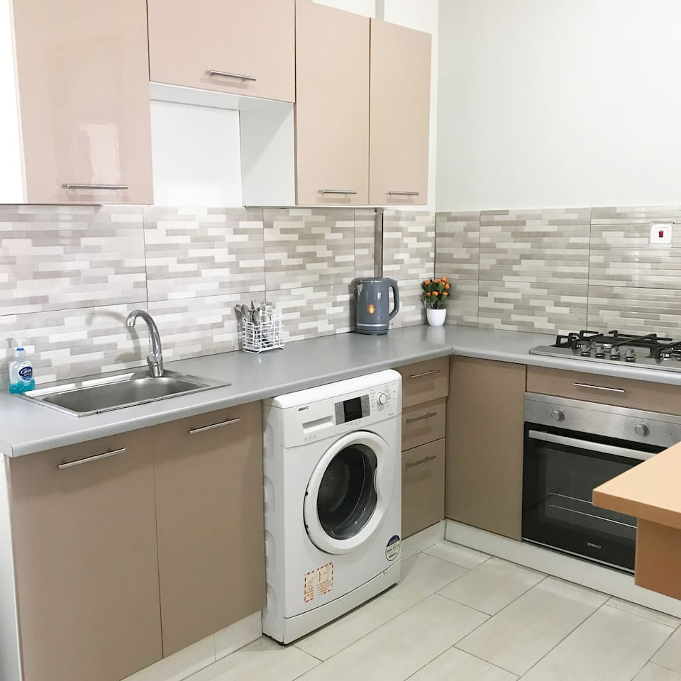Fully equipped kitchen with stove top, oven, microwave, fridge and washing machine!! 1st view